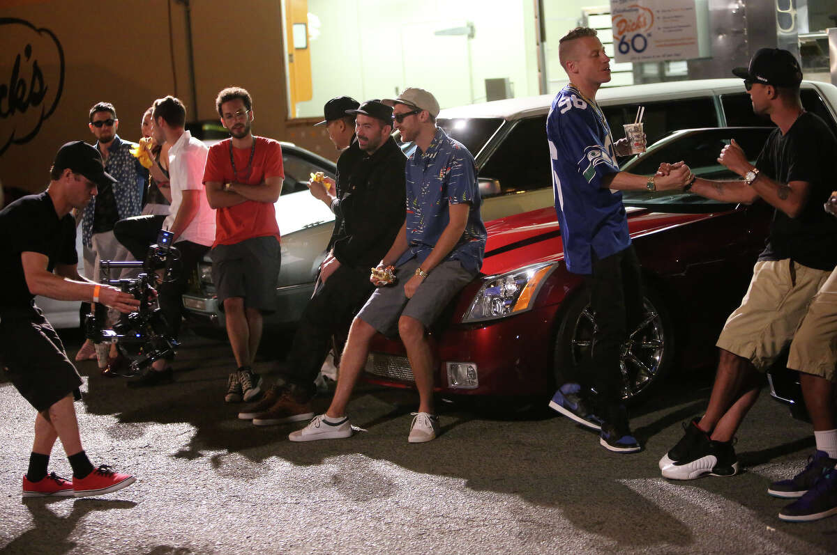 Macklemore and Ryan Lewis perform for a video shoot on Wednesday at the Capitol Hill Dick's Drive-In.