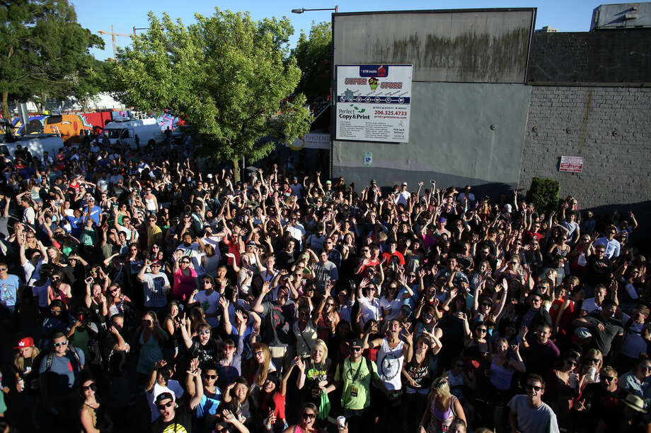 People are shown in the parking lot on Wednesday at the Capitol Hill Dick's Drive-In.  Photo: JOSHUA TRUJILLO, SEATTLEPI.COM / SEATTLEPI.COM