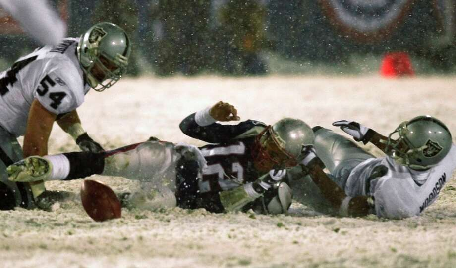 Everyone involved with the Tuck Rule Tom Brady, the snow, referee Walt Coleman. All blacklisted by Raiders fans. Photo: Elise Amendola, File, AP