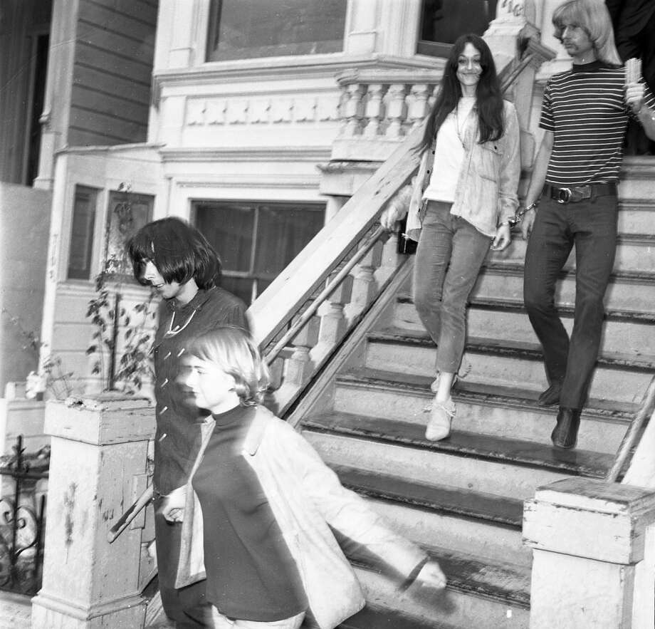 Oct. 2, 1967: Band managers Rock Scully and Danny Rifkin are led out of 710 Ashbury St. Other members of the band -- including Jerry Garcia and Phil Lesh -- were not present and avoided arrest. Photo: Barney Peterson, The Chronicle