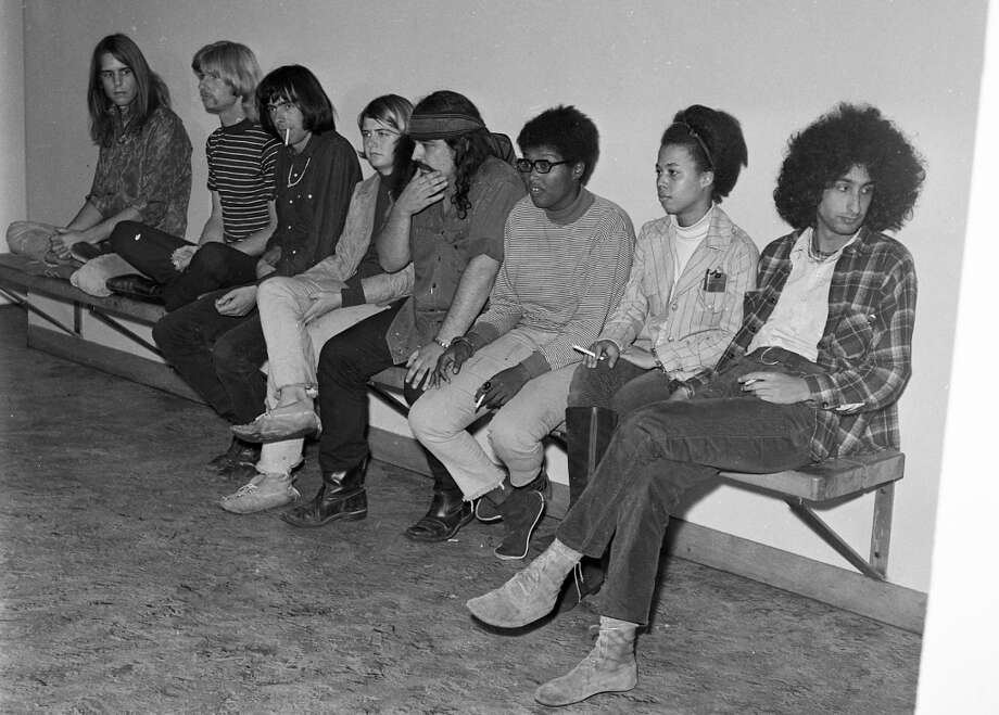 Oct. 2, 1967: Another photo of the Grateful Dead and their friends handcuffed at the Hall of Justice, waiting for word from their lawyer. Photo: Barney Peterson, The Chronicle