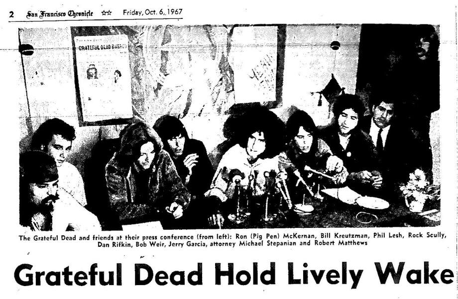 Oct. 6, 1967: The band invited the media over for cookies, cake and a press conference. Jerry Garcia and others not arrested attended. Note the Chronicle front page posted on the back wall.