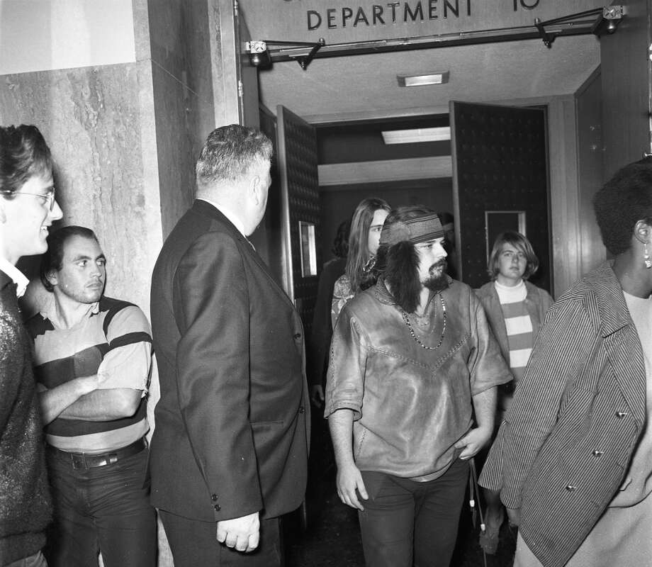 "Nov. 6, 1967: Ronald ""Pigpen"" McKernan walks into court (with Bob Weir behind him) for a rebooking after a grand jury indicted the band members and their friends. Photo: Barney Peterson, The Chronicle"