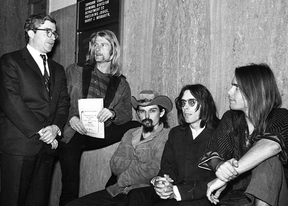 "June 23, 1968: Robert Matthews, Ron ""Pigpen"" McKernan, Rock Scully and Bob Weir at their sentencing. They paid either $100 or $200 and got probation in exchange for a guilty plea. Photo: Gordon Peters, The Chronicle"