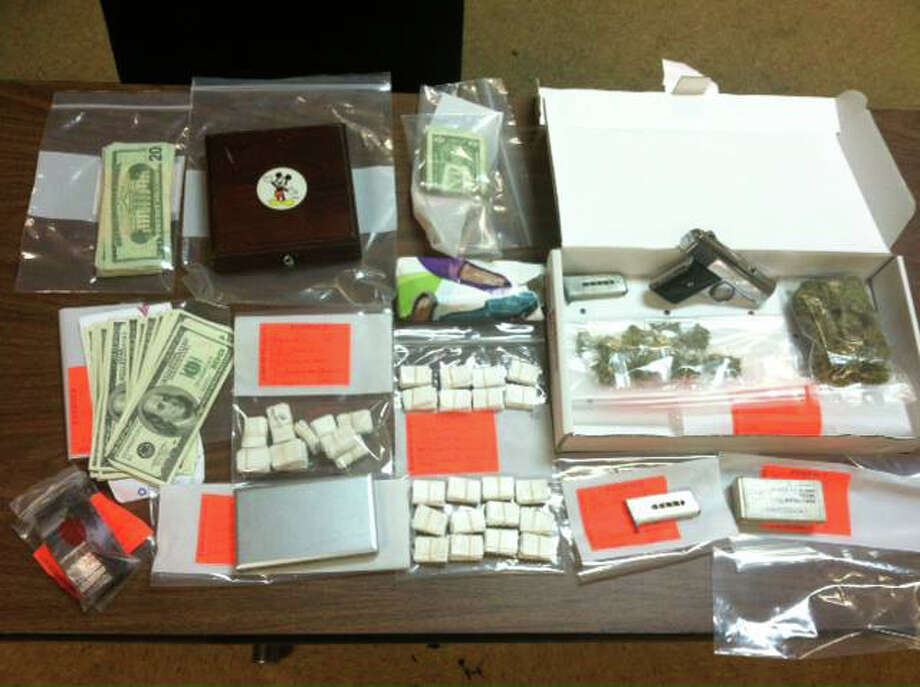 Police seized 300 bags of heroin, marijuana, a loaded gun and $3,500 in cash after a parking dispute led to the arrest of a father and son on Stamford's West Side on Wednesday, July 24, 2013. Photo: Contributed Photo