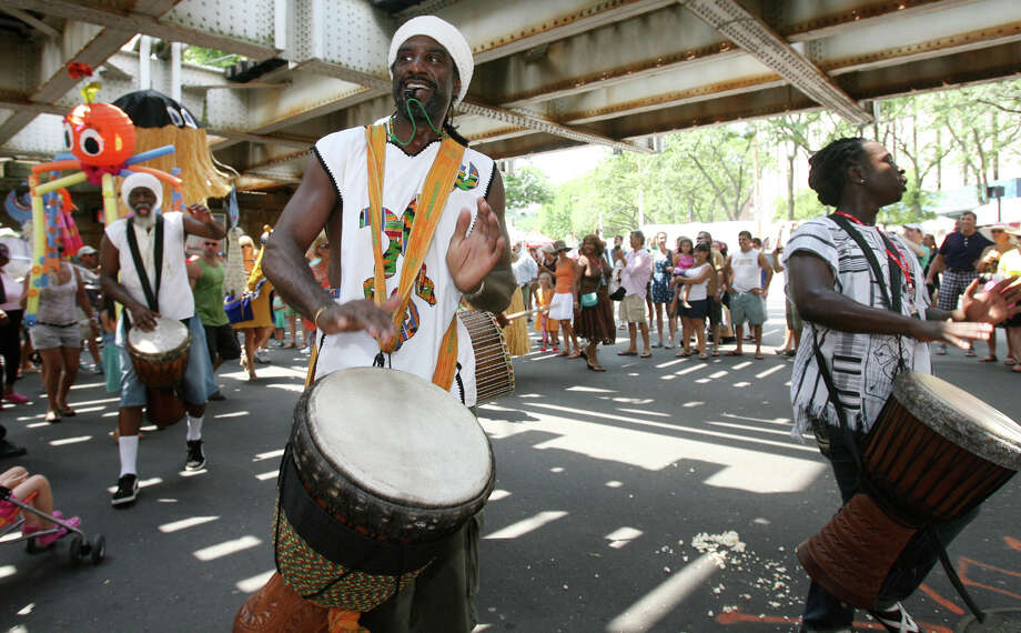 Sounds of Afrika band member, Kojo Bey, center, leads the puppet parade at the 37th annual SoNo Arts Celebration on Sunday, Aug. 5, 2012. The celebration is back, Saturday to Sunday, Aug. 3 to 4, 2013. This year's puppet parade is set for 1 p.m., Sunday, Aug. 4, 2013. Photo: File Photo / Stamford Advocate File Photo