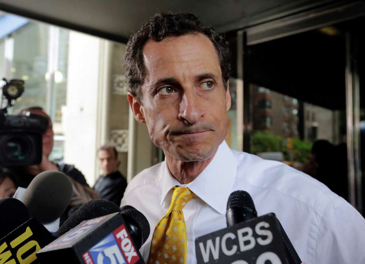 New York City mayoral candidate Anthony Weiner leaves his apartment building in New York on Wednesday, July 24, 2013. The former congressman acknowledged sending explicit text messages to a woman as recently as last summer, more than a year after sexting revelations destroyed his congressional career. (AP Photo/Richard Drew) ORG XMIT: NYRD102