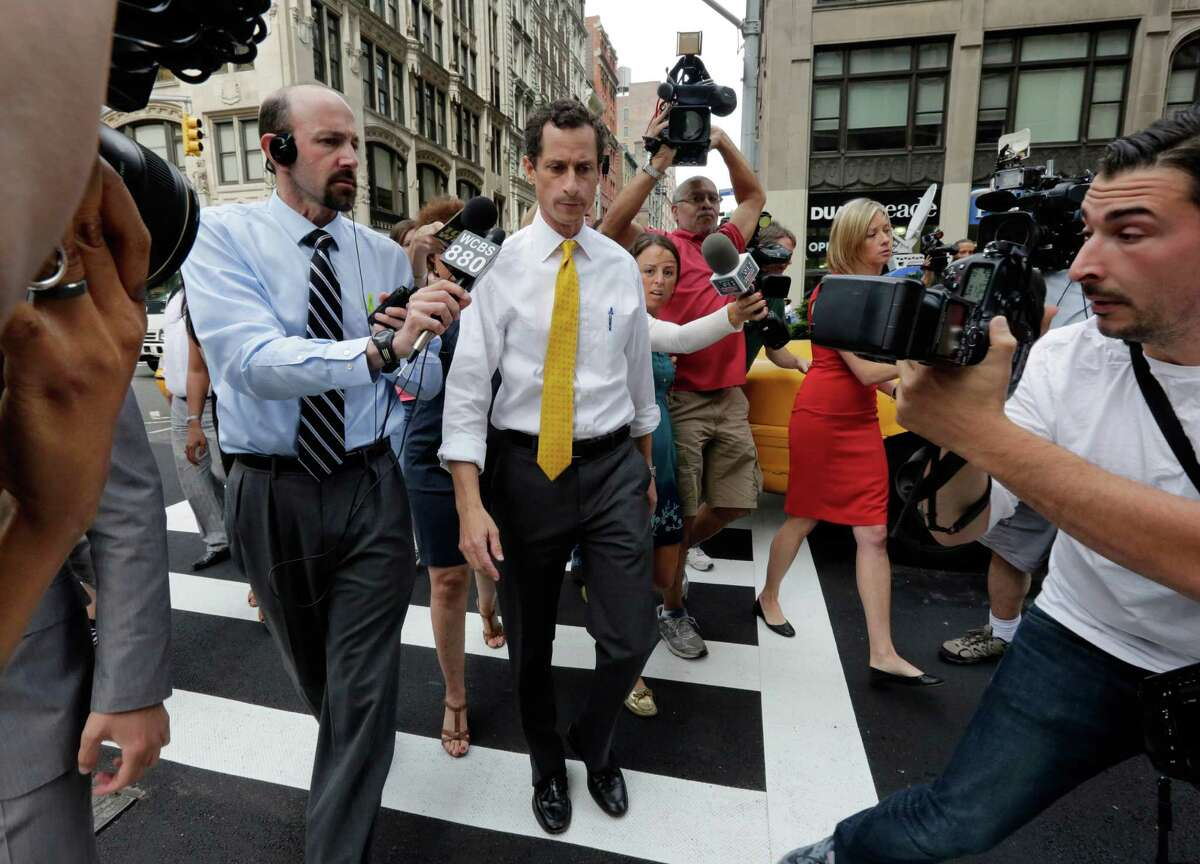 New York City mayoral candidate Anthony Weiner is pursued by reporters after leaving his apartment in New York on Wednesday, July 24, 2013. The former congressman acknowledged sending explicit text messages to a woman as recently as last summer, more than a year after sexting revelations destroyed his congressional career. (AP Photo/Richard Drew) ORG XMIT: NYRD105
