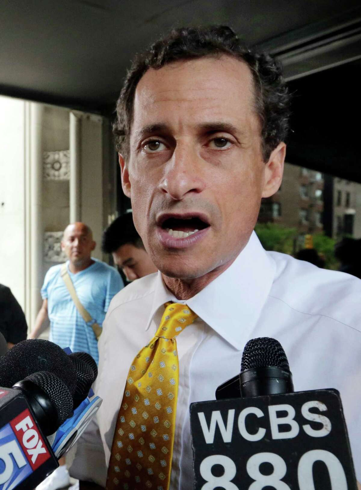 New York City mayoral candidate Anthony Weiner speaks to reporters as he leaves his apartment building in New York on Wednesday, July 24, 2013. The former congressman acknowledged sending explicit text messages to a woman as recently as last summer, more than a year after sexting revelations destroyed his congressional career. (AP Photo/Richard Drew) ORG XMIT: NYRD107