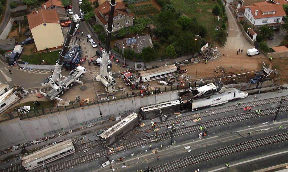 An aerial view shows the site of a train accident near the city of Santiago de Compostela on July 25, 2013. A train hurtled off the tracks on July 24, 2013 in northwest Spain killing at least 77 passengers and injuring more than 140, an official said today, the country's deadliest rail disaster in more than 40 years. Photo: -, AFP/Getty Images / 2013 AFP