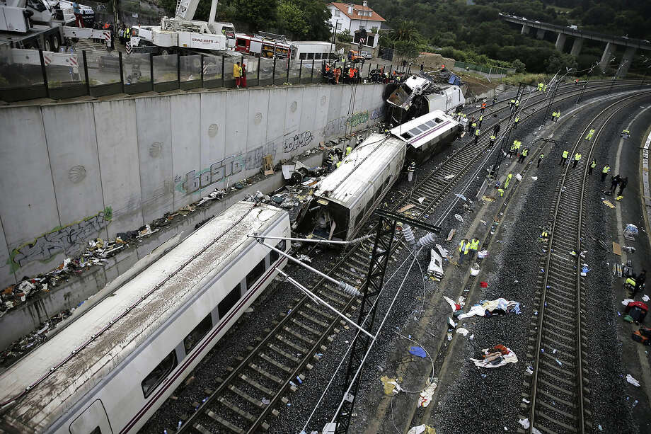 Rescuers, forensics and police officers work at the site of a train accident near the city of Santiago de Compostela on July 25, 2013. A train hurtled off the tracks on July 24, 2013 in northwest Spain killing at least 77 passengers and injuring more than 140, an official said today, the country's deadliest rail disaster in more than 40 years. Photo: AFP, AFP/Getty Images / 2013 AFP