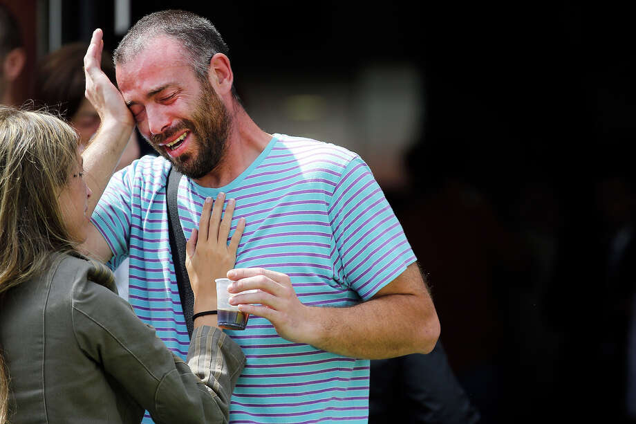 Relatives of the victims of a train accident react outside the Cersia building, where they are attended by psychologists from the Red Cross in Santiago de Compostela on July 25, 2013. A train hurtled off the tracks on July 24 in northwest Spain killing at least 77 passengers and injuring more than 140, an official said today, the country's deadliest rail disaster in more than 40 years. Photo: CESAR MANSO, AFP/Getty Images / 2013 AFP