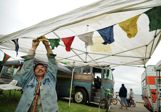 Spin Ray Gelinas of Wolcott hangs a string of prayer flags on his campsite at the 18th annual Gathering of the Vibes Musical Festival at Seaside Park in Bridgeport, Conn. on Thursday, July 25, 2013. Photo: Brian A. Pounds / Connecticut Post freelance
