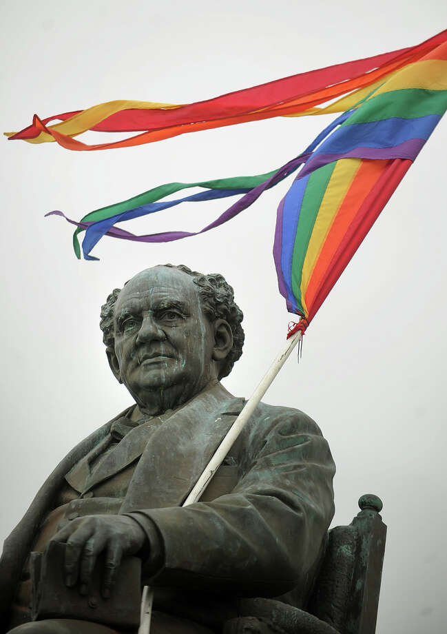 The P.T. Barnum statue is adorned with a rainbow colored flag at the 18th annual Gathering of the Vibes Musical Festival at Seaside Park in Bridgeport, Conn. on Thursday, July 25, 2013. Photo: Brian A. Pounds / Connecticut Post freelance