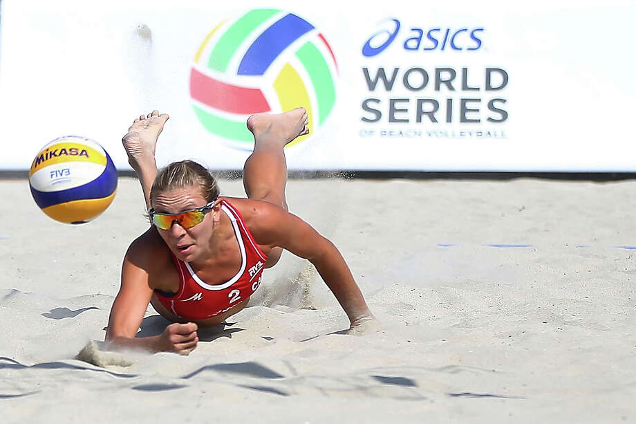 Kristina Valjas of Canada dives for the ball during play at the ASICS World Series of Beach Volleyball - Day 2 on July 23, 2013 in Long Beach, California. Photo: Joe Scarnici, Getty Images / 2013 Getty Images