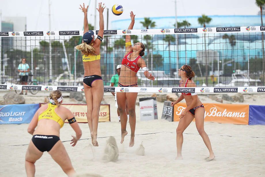 Julia Grossner of Germany (center R) blocks a spike by Barbara Hansel of Austria at the ASICS World Series of Beach Volleyball - Day 2 on July 23, 2013 in Long Beach, California. Photo: Joe Scarnici, Getty Images / 2013 Getty Images
