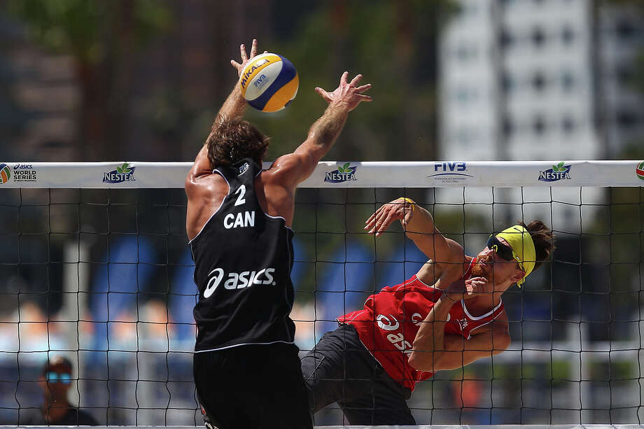 Sam Pedlow of Canada in action against Ben Saxton of Canada at the ASICS World Series of Beach Volleyball - Day 2 on July 23, 2013 in Long Beach, California. Photo: Joe Scarnici, Getty Images / 2013 Getty Images