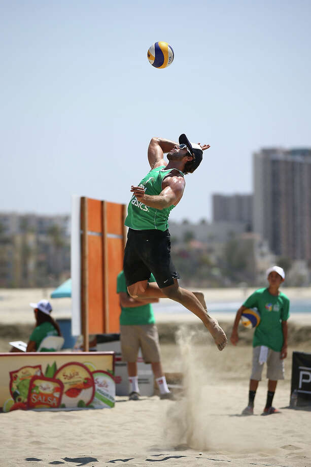Pedro Salgado of Brazil serves the ball during play at the ASICS World Series of Beach Volleyball - Day 2 on July 23, 2013 in Long Beach, California. Photo: Joe Scarnici, Getty Images / 2013 Getty Images