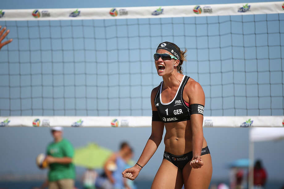 Katrin Holtwick of Germany celebrates a point during the first elimination round at the ASICS World Series of Beach Volleyball - Day 3 on July 24, 2013 in Long Beach, California. Photo: Joe Scarnici, Getty Images / 2013 Getty Images