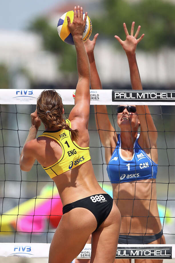 Zara Dampney of Great Britain (L) spikes the ball over Martina Bonnerova of Czech Republic during the round of pool play at the ASICS World Series of Beach Volleyball - Day 3 on July 24, 2013 in Long Beach, California. Photo: Joe Scarnici, Getty Images / 2013 Getty Images