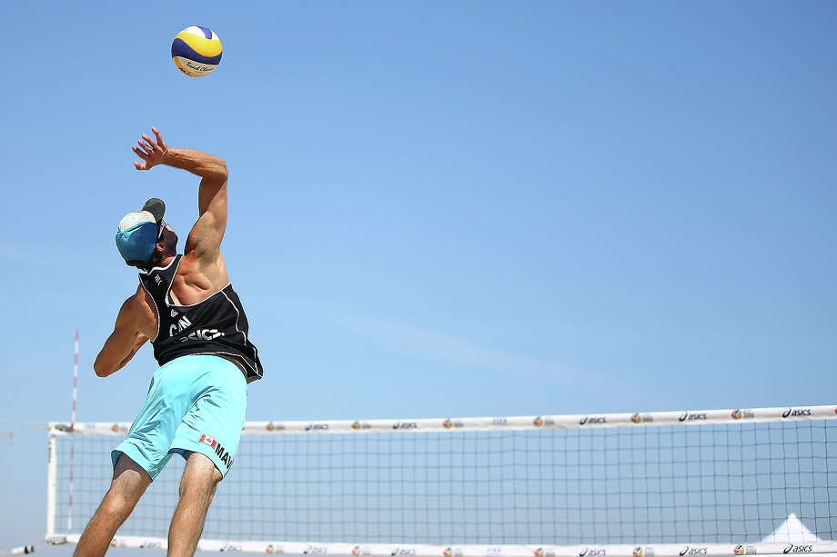 Maverick Hatch of Canada serves the ball into play during the round of pool play at the ASICS World Series of Beach Volleyball - Day 3 on July 24, 2013 in Long Beach, California. Photo: Joe Scarnici, Getty Images / 2013 Getty Images