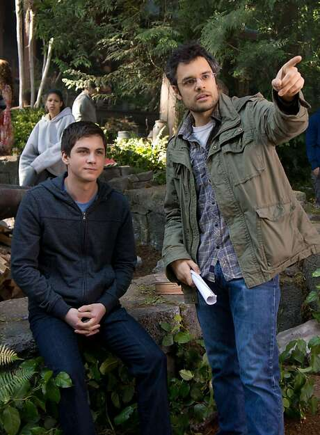 """On the set of """"Percy Jackson:  Sea of Monsters,"""" Logan Lerman (left), who plays the title character, gets some direction from filmmaker Thor Freudenthal. Photo: Murray Close"""