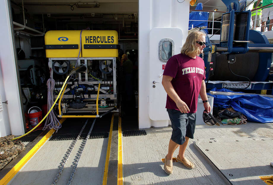Principal Investigator Fritz Hanselmann walks in front of the Hercules after the Nautilus returned from an approximately 170-trip off Galveston from investigating a shipwreck, Thursday, July 25, 2013, in Galveston. Investigators used the Remote Operating Vehicle, Hercules, during their exploration. The crew brought back about 60 artifacts and plan to determine the ship's origin from studying the artifacts. Photo: Cody Duty, Houston Chronicle / © 2013 Houston Chronicle