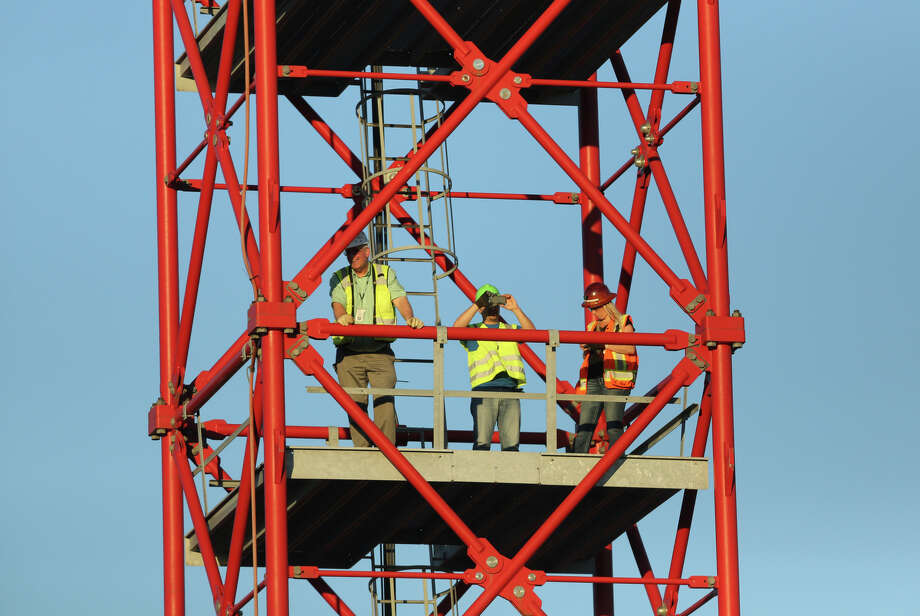 Workers watch from a crane on the site of the Capitol Hill light rail station watch the action far below. Photo: JOSHUA TRUJILLO, SEATTLEPI.COM / SEATTLEPI.COM