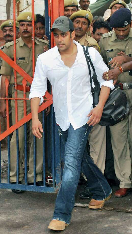 FILE – In this Aug. 31, 2007 file photo, Bollywood actor Salman Khan steps out of the Jodhpur Central Jail where he had been held for a poaching case in Jodhpur, India. A Mumbai court has ruled Wednesday, July 23, 2013 that Indian movie star Salman Khan will face trial on charges of homicide for his alleged involvement in a fatal road accident more than 10 years ago. One man was killed and another four were injured when Khan allegedly rammed his car into a group of homeless people sleeping on a Mumbai sidewalk in September 2002. Photo: File