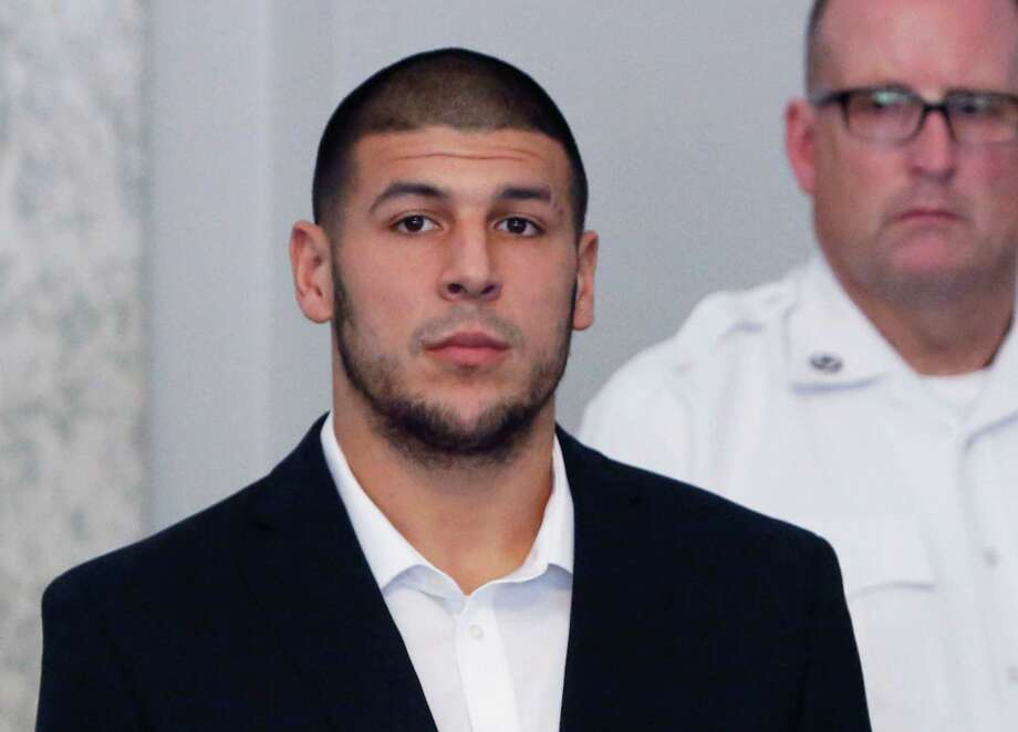 Former New England Patriots NFL football tight end Aaron Hernandez appears during a probable cause hearing at Attleboro District Court, on Wednesday, July 24, 2013, in Attleboro, Mass. Hernandez has pleaded not guilty to murder in the death of Odin Lloyd, a 27-year-old Boston semi-professional football player whose body was found June 17 in an industrial park in North Attleboro near Hernandez's home. Photo: Bizuayehu Tesfaye