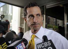 AP10ThingsToSee - New York City mayoral candidate Anthony Weiner leaves his apartment building in New York on Wednesday, July 24, 2013. The former congressman acknowledged sending explicit text messages to a woman as recently as last summer, more than a year after sexting revelations destroyed his congressional career. (AP Photo/Richard Drew, File)