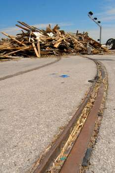Galveston trolley tracks leading to the debris of the Balinese Room caused by Hurricane Ike. Photo: For The Chronicle