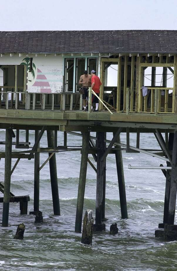 April 17, 2002: Construction workers rebuild a section of the Balinese Room that extends over the Gulf of Mexico in Galveston, Texas. Houston developer Steve Arnold is renovating the historic building, which once housed a nightclub and illegal casino. Arnold plans to reopen the building next month. During its heyday the building hosted luminaries like Frank Sinatra, Groucho Marx, Henny Youngman and Tony Bennett in their primes, their hefty booking fees backed by revenues from the illegal casino. Photo: AP