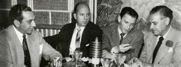 Undated: Frank Sinatra, appearing at Houston's Shamrock Hotel during Galveston's gambling heyday, dropped down to the Balinese Room on his night-off to socialize with, from left,  Anthony Fertitta, Jimmy Van Heusen, and Sam Maceo. Photo: Rosenberg Library,  Galveston