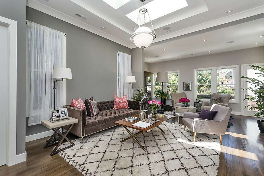 Skylights illuminate the living room, while ebony-stained oak floors span the space of the recently remodeled Victorian. Photo: Olga Soboleva/Vanguard Propertie