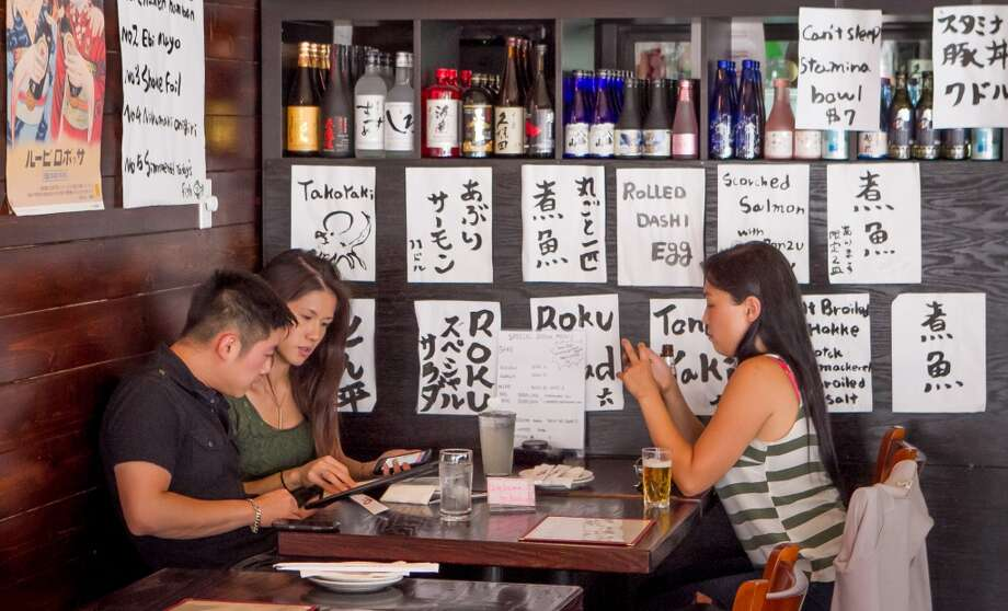 Diners enjoy dinner at Izakaya Roku in San Francisco.. Photo: John Storey, Special To The Chronicle