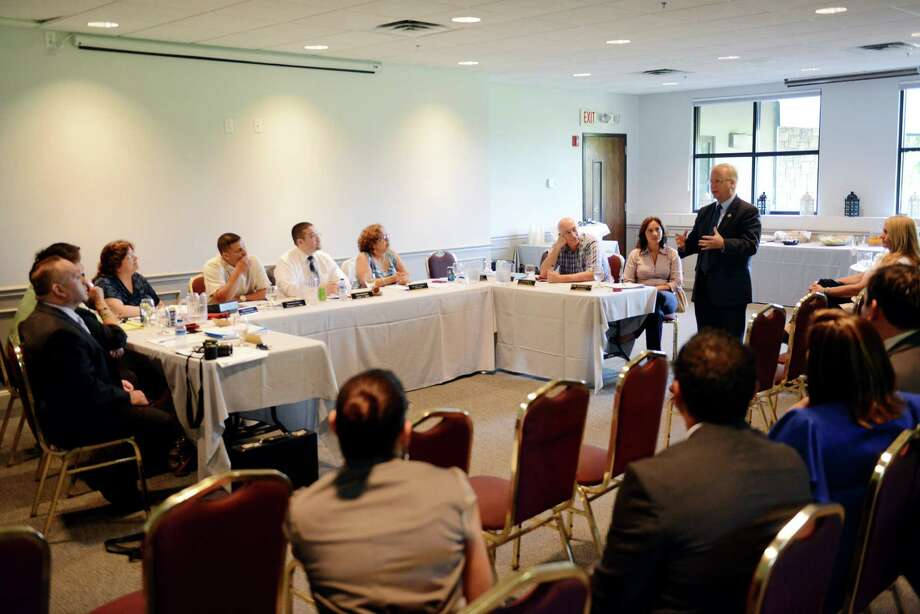 Danbury Mayor Mark Boughton, right, speaks at the Latino and Puerto Rican Affairs Commision meeting at the Portuguese Cultural Center in Danbury, Conn. on Wednesday, July 17, 2013. Photo: Tyler Sizemore / The News-Times