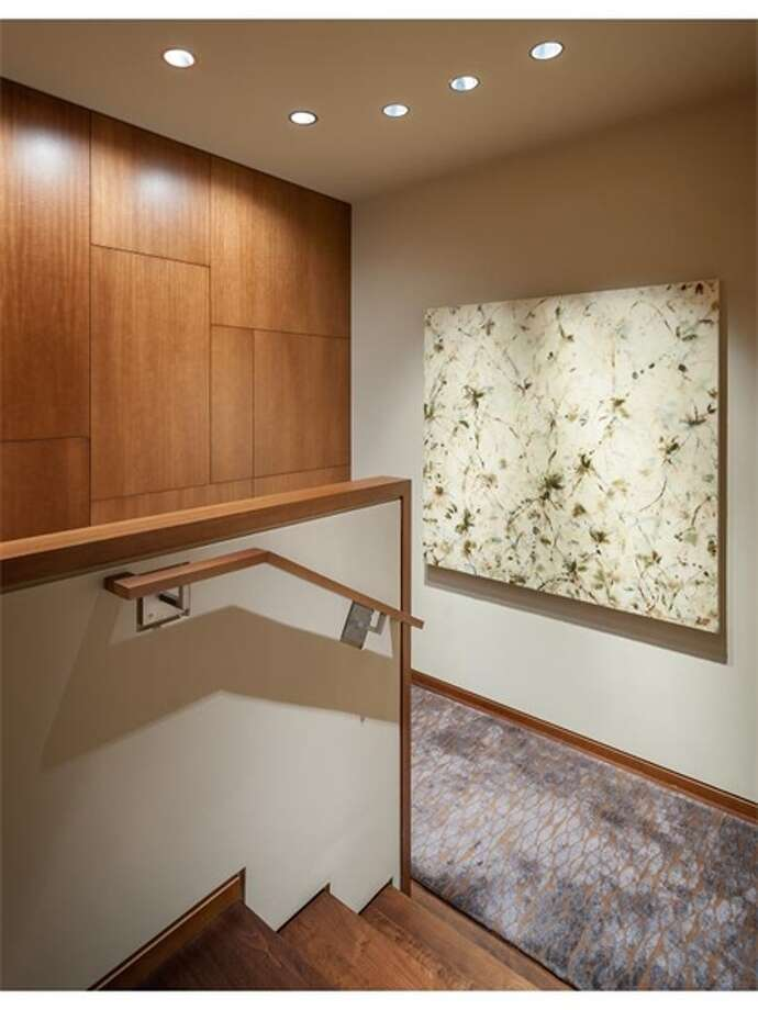 Walnut staircase of 715 2nd Ave., Unit 1504. It's listed for $2.7 million. Photo: Courtesy Julie Biniasz, Realogics Sotheby's International Realty