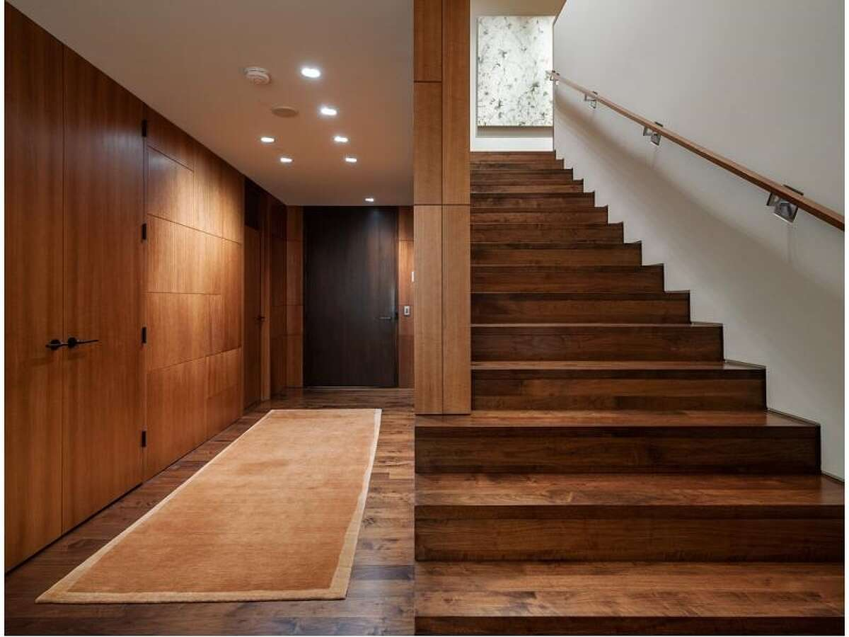 Entry and walnut staircase of 715 2nd Ave., Unit 1504. It's listed for $2.7 million.