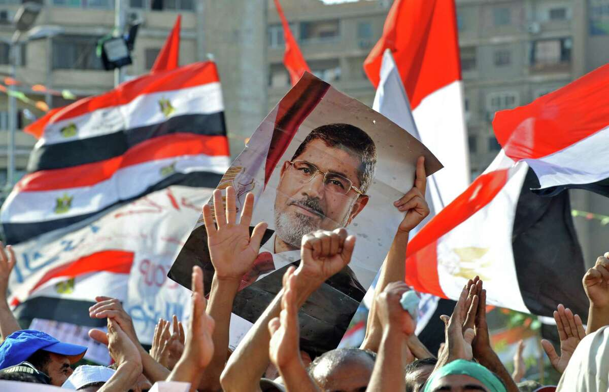 #1: Who is that guy on the poster? President Mohamed Morsi was ousted from power on July 3. Morsi was the first democratically elected president for Egypt. Morsi held the position for about a year before opposition moved for his dismissal. The spark for the unseating were several outages that took place across the country.
