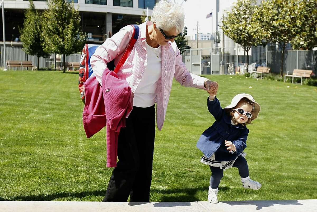 Catriona Mactaggart plays with her granmother at the opening of a public park that will be fully funded by the Emerald Fund, who's property it is located at, on Thursday, July 25, 2013 in San Francisco, Calif.
