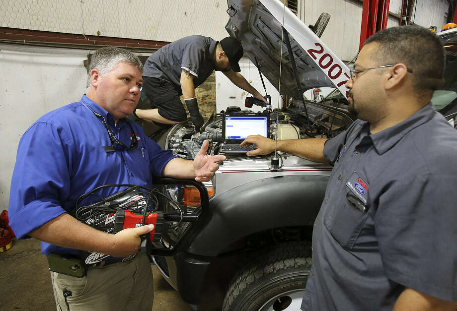 Mike Davis (left), commercial sales and service manager at Jordan Ford, talks with shop foreman Daniel Mejia. Photo: Tom Reel / San Antonio Express-News