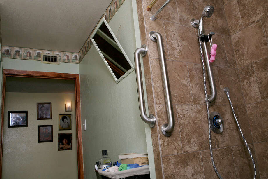 Hector and Maria Marin's bathroom in their Floresville home was redone with help from a Texas Veterans Commission program. Photo: Cynthia Esparza / For The Express-News