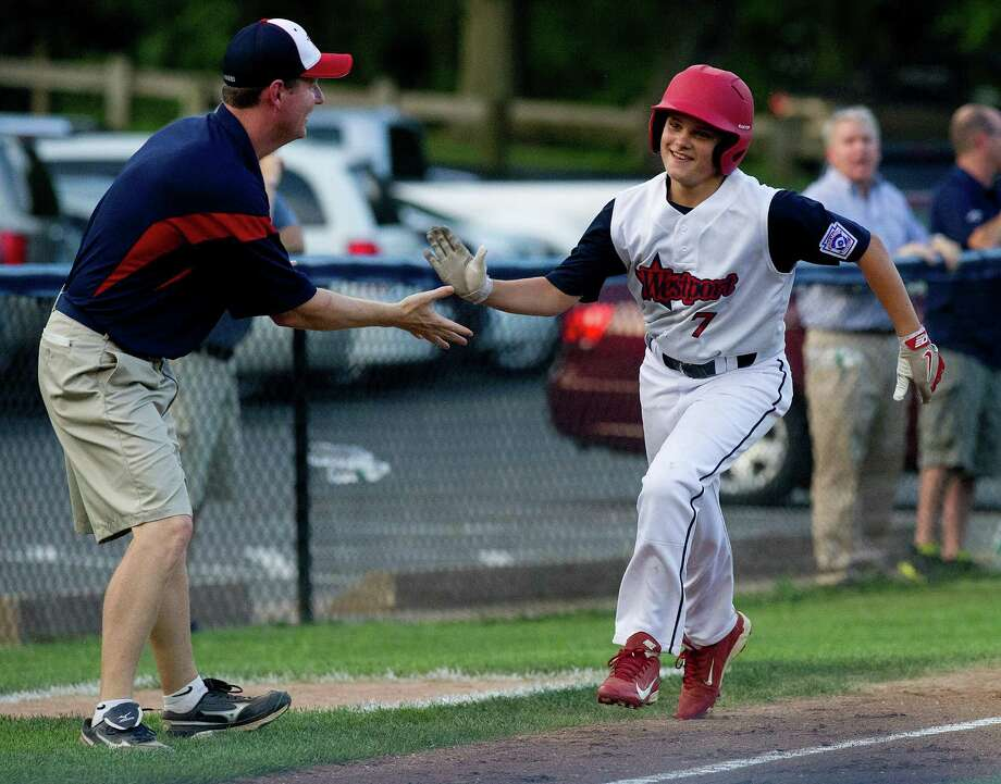 Westport's Charlie Roof gets a high-five as he rounds the bases after hitting a home run during Thursday's Section 1 Little League tournament against Edgewood at Springdale Little League Field in Stamford, Conn., on July 18, 2013. Photo: Lindsay Perry / Stamford Advocate
