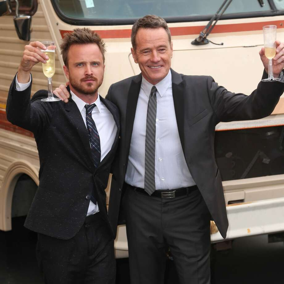 Actors Aaron Paul (L) and Bryan Cranston arrive as AMC Celebrates the final episodes of 'Breaking Bad' at Sony Pictures Studios on July 24, 2013 in Culver City, California.  (Photo by Imeh Akpanudosen/Getty Images) Photo: Imeh Akpanudosen, Getty Images