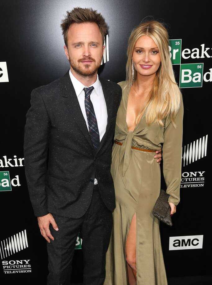 Actor Aaron Paul (L) and his wife, Lauren Parsekian, arrive as AMC Celebrates the final episodes of 'Breaking Bad' at Sony Pictures Studios on July 24, 2013 in Culver City, California.  (Photo by Imeh Akpanudosen/Getty Images) Photo: Imeh Akpanudosen, Getty Images