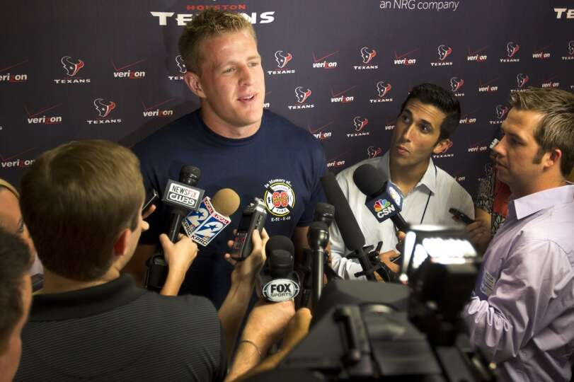 J.J. Watt talks to reporters.