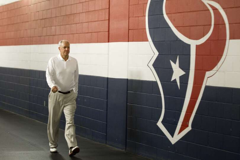 Team owner Bob McNair walks to the locker room
