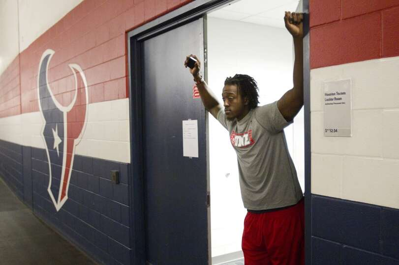 Rookie safety Orhian Johnson stands in the doorway of the Houston Texans locker room.