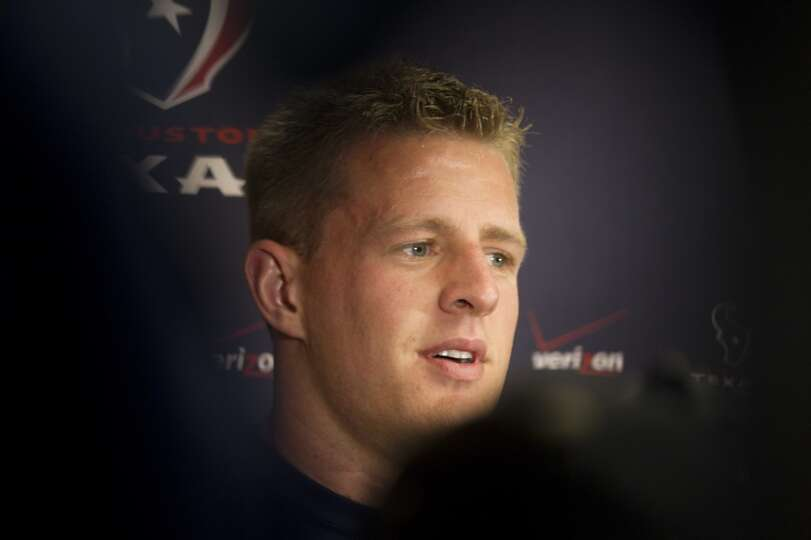 Defensive end J.J. Watt talks to reporters.